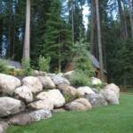 Beatifully landscaped boulder wall